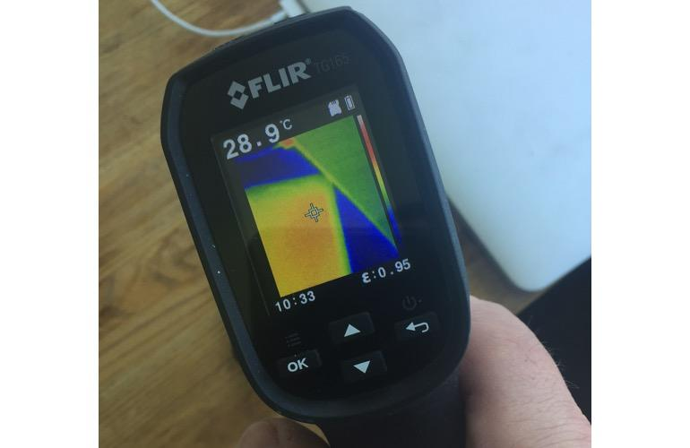 Using a Flir TG165 to measure the temperature of my iPhone 8 Plus -- here it's running very hot even when locked