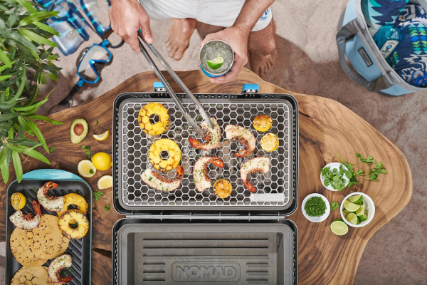 Nomad's charcoal grill suitcase is modern ingenuity combined with classic cooking